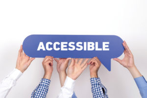 Hands Propping up the Word Accessible