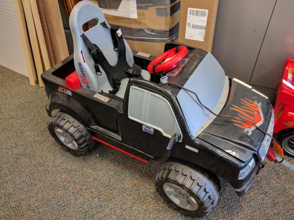 Childs mobility scooter built from PowerWheels toy