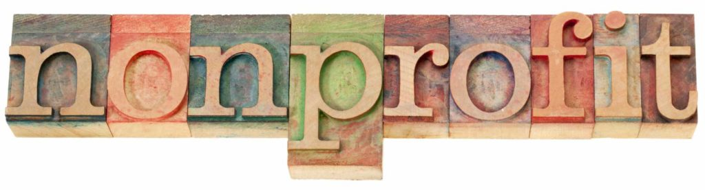 The word nonprofit spelled out with wooden block letters
