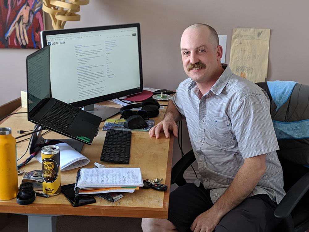 Peter Jewett sitting at desk