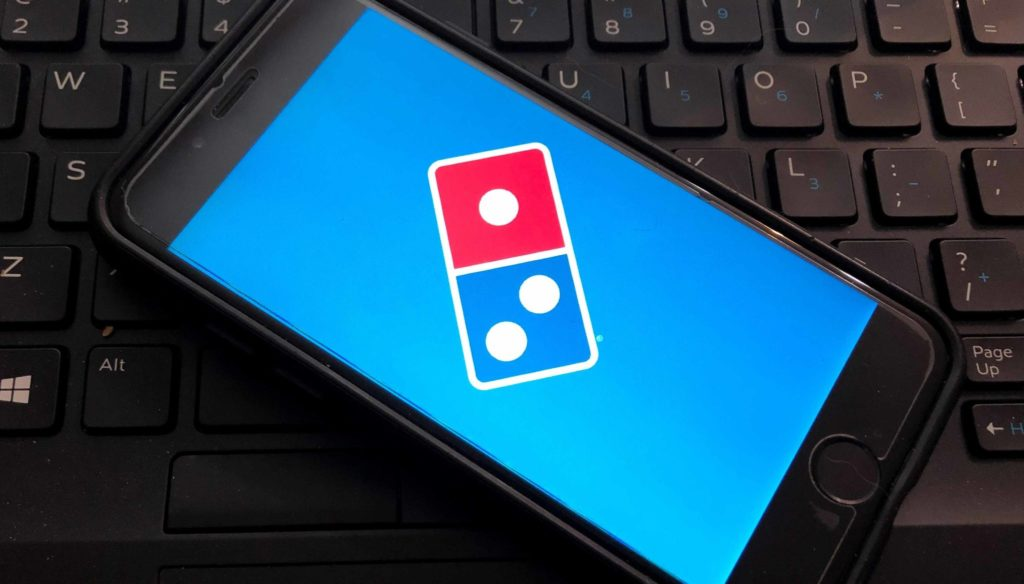 Dominos logo on the screen of a smartphone