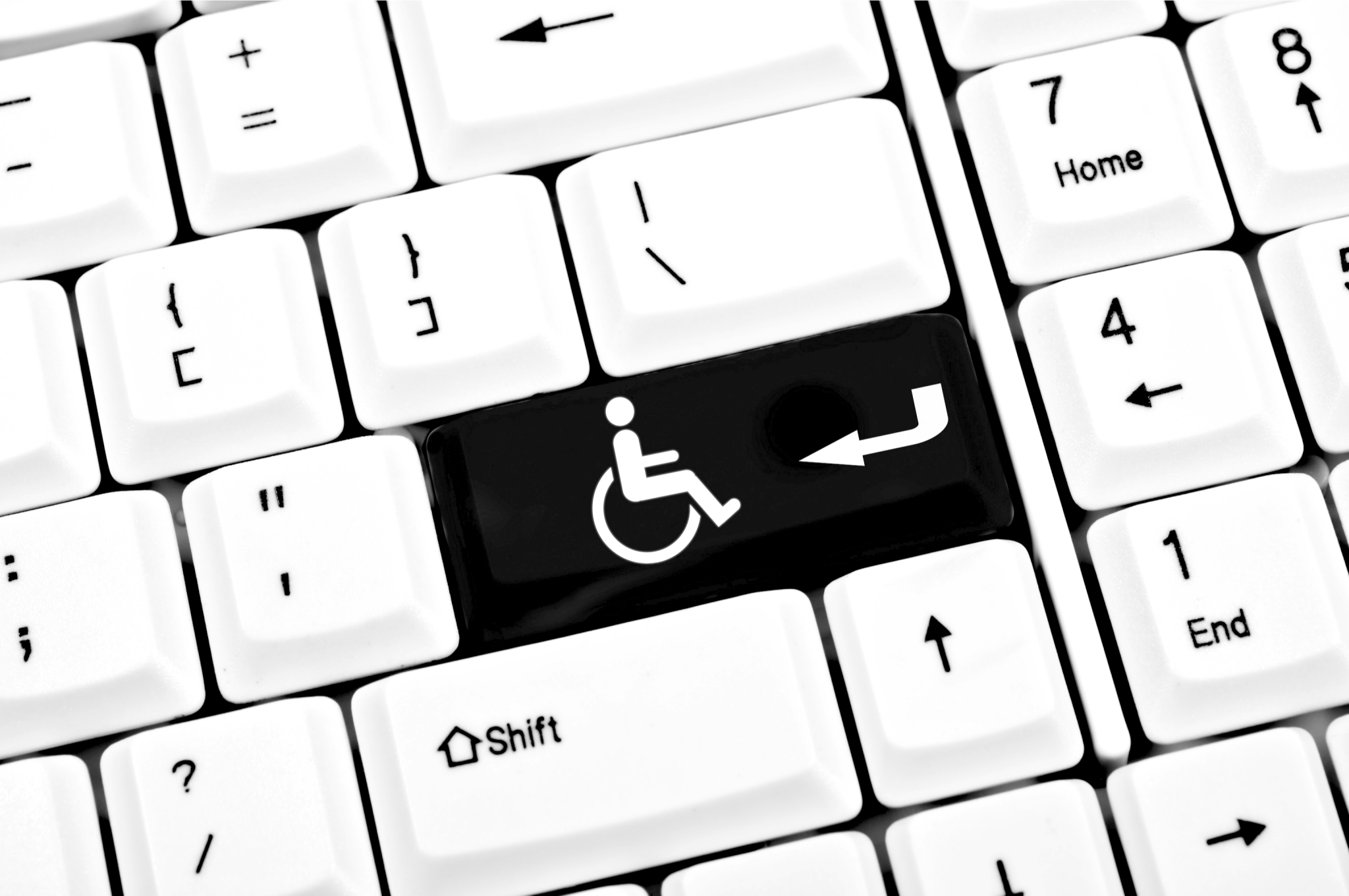 keyboard with handicap sign for return key