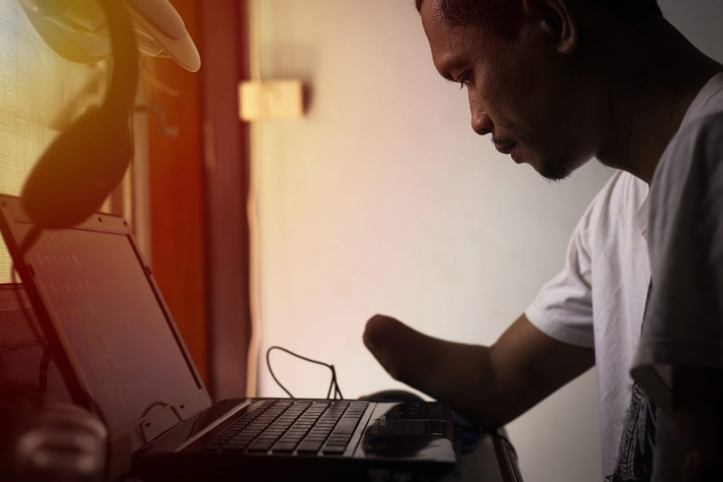 Person with a physical disability using a computer
