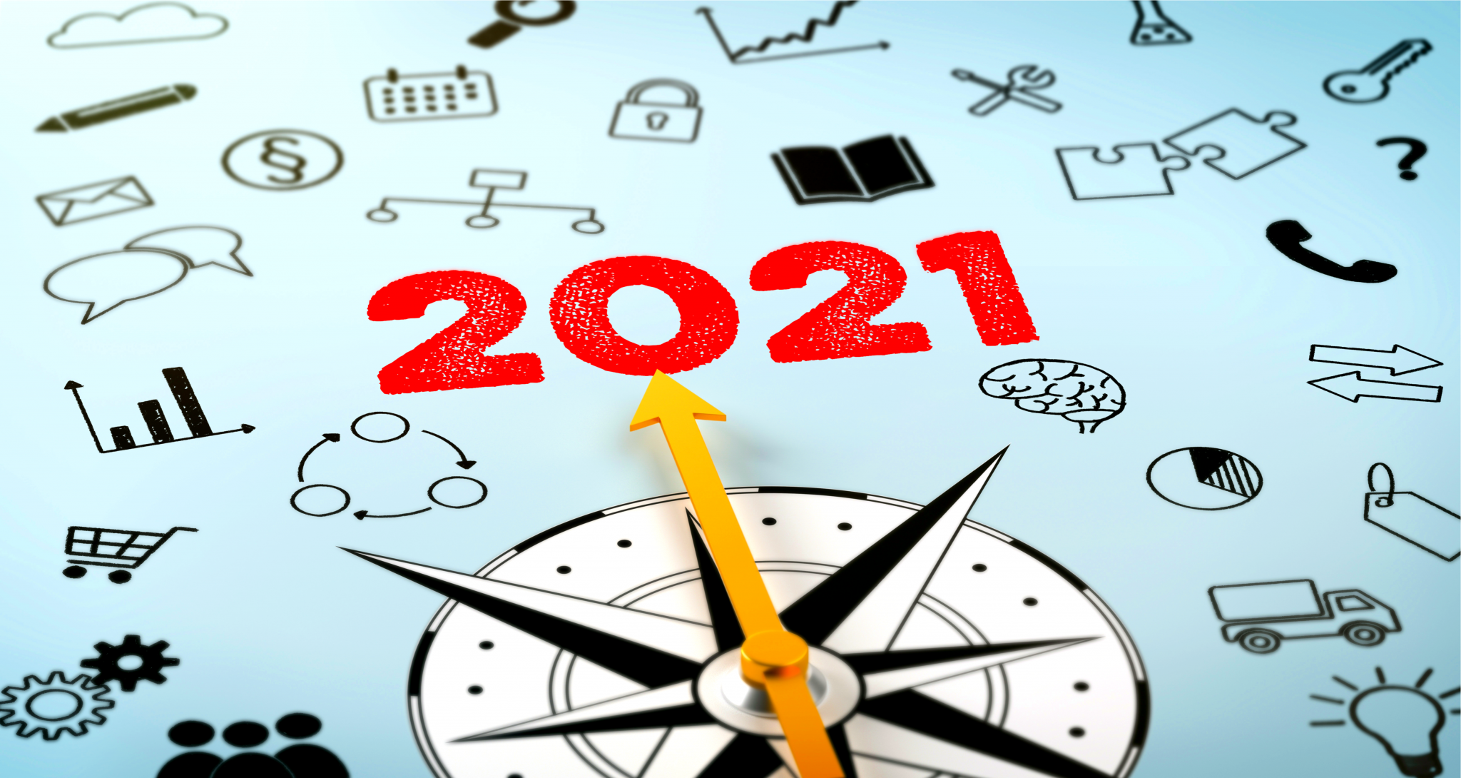 A compass with the arrow pointing at the text 2021