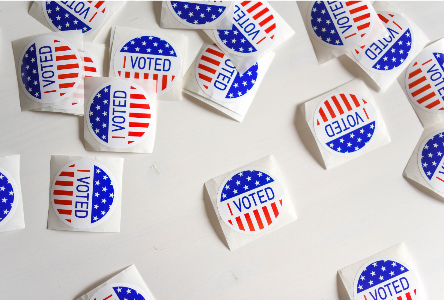 Voting stickers scattered on a white background